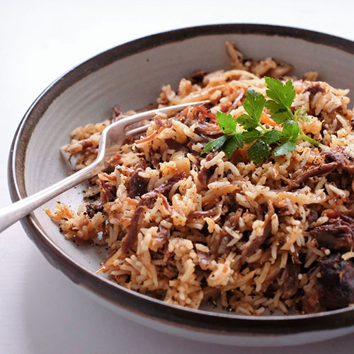 R & P organic shredded lamb with caramelized onion and rice